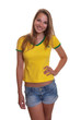 Woman in brazilian shirt laughing at camera