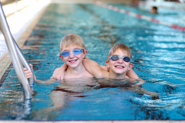 Twin brothers having fun in swimming pool