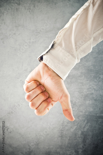 Businessman showing thumb down