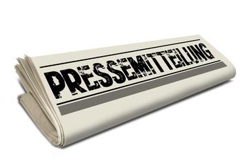 Zeitungsrolle mit Pressemitteilung