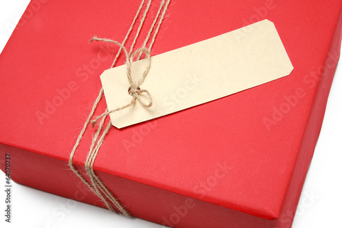 A bow from a string on a red box wrapping