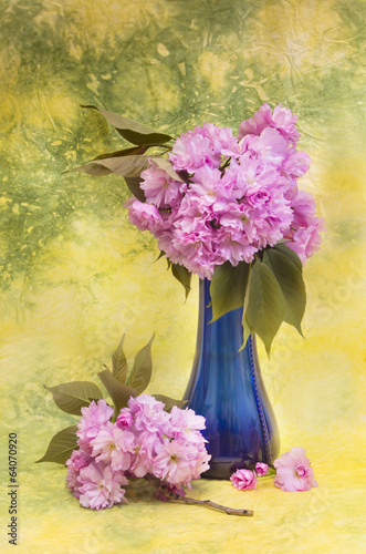 Sakura flowers in a blue vase.