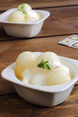 Melon balls with mint-flavored yogurt