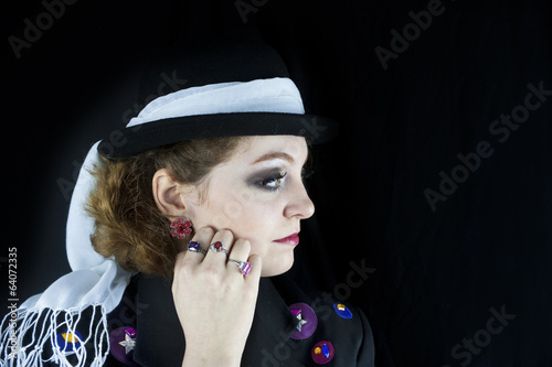 Profile of woman wearing hat