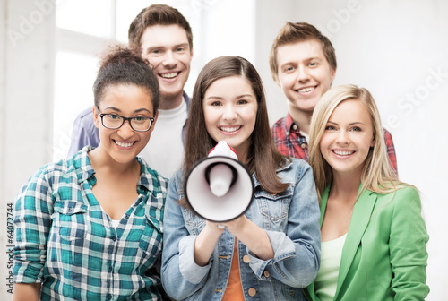 group of students with megaphone at school