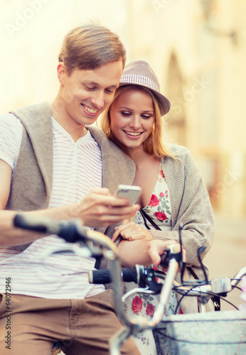 couple with bicycles in the city