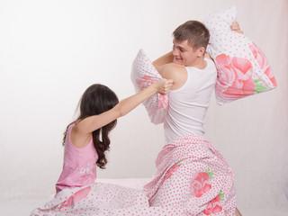 Husband beats his wife pillow