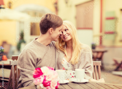romantic happy couple kissing in the cafe