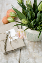 Bouquet of delicate pink tulips on a wooden background
