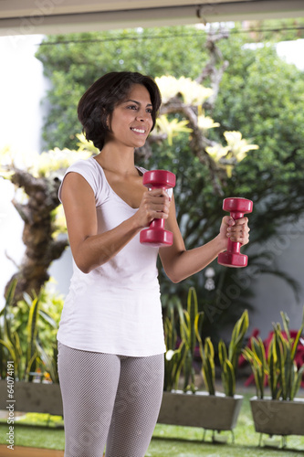 Attractive Woman Exercising With Dumbbells.