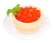 Red caviar in tartlet on little white saucer isolated on white