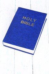 Bible on blue wooden table close-up