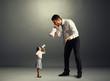 quarrel between small woman and big man