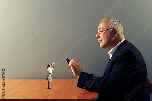 man with loupe and small woman
