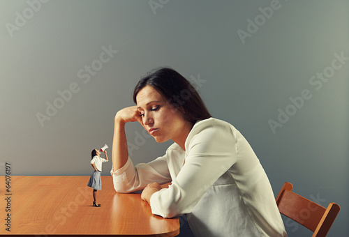 small woman urging on tired woman