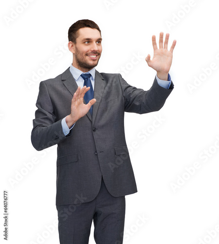businessman working with imaginary virtual screen