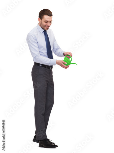 handsome buisnessman with green watering can