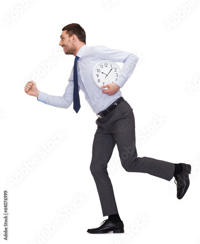 smiling young businessman with clock running