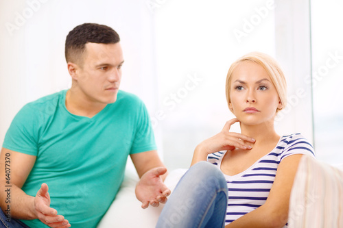 unhappy couple having argument at home