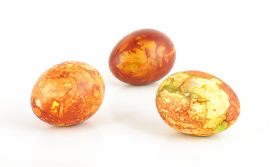 Three traditional painted Easter eggs on the bright background