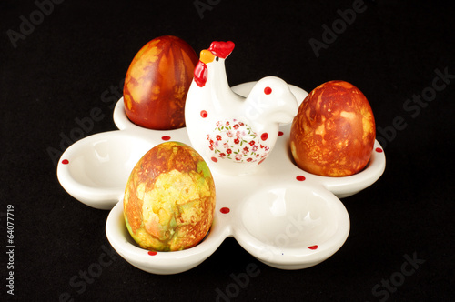 Easter eggs case with three painter traditional eggs