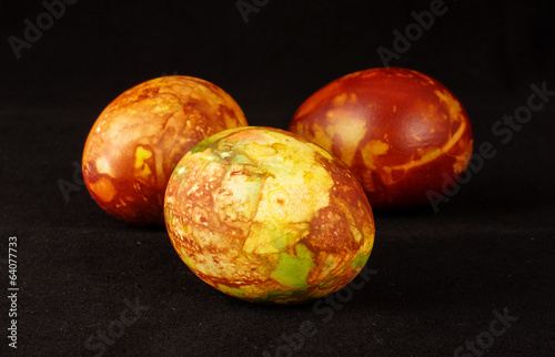 Three traditional painted Easter eggs on the dark background