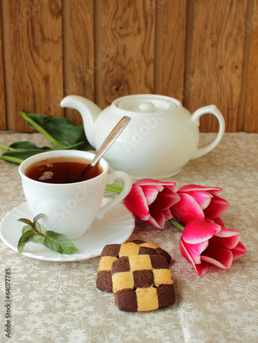 Tea set, cookies and tulips.