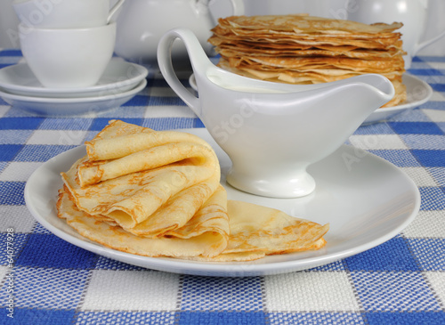 pancakes on a plate with milk sauce