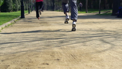 Joggers feet running in the park
