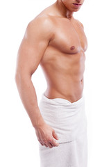 Handsome muscular man in towel, isolated on white