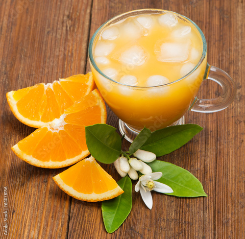 canvas print picture Orange slices and orange juice