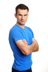 Portrait of handsome a man standing at blue shirt