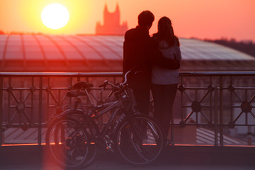Couple enjoying scenic sunset in the city