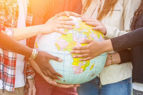 Group of Teenagers Holding World Globe Map - 64078945