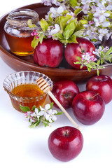 .apples in a bowl with honey and apple flower