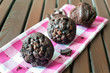 Delicious homemade chocolate muffins on checkered tablecloth.