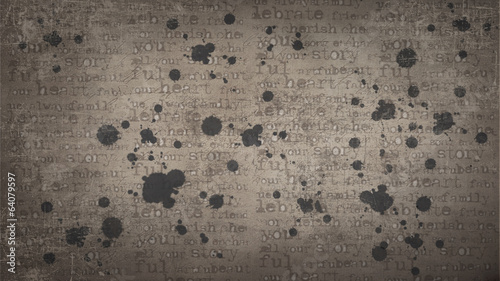 Texture with printed letters and blots.