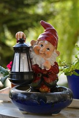A garden dwarf with solar lamp