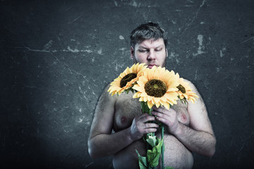 Studio shoot of man with bouquet  sunflowers