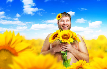Portrait of man in sunflower field