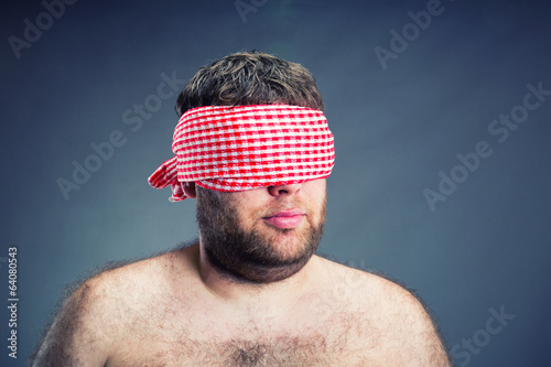 Portrait of the  man blindfold , isolated on gray