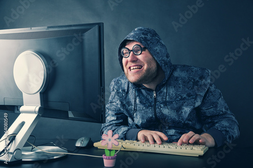 Man sitting at desk looking on computer screen