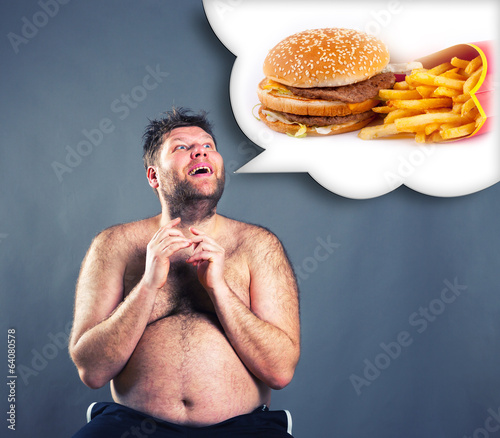 Fat funny man dreaming about  hamburger