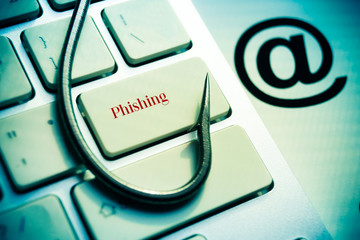 phishing / fish hook on computer keyboard