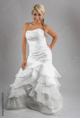The beautiful young woman posing in a wedding strapless dress. B