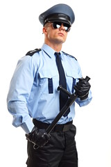 Policeman in sunglasses holds at hand police baton