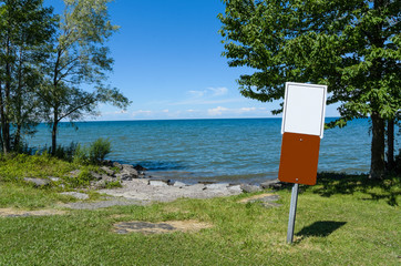 Blank Signs at Water Edge