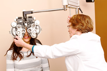 Senior optician getting ready to do eye testing