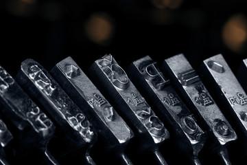 Old typewriter. Typebars closeup.