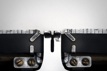 Old typewriter. Blank paper.
